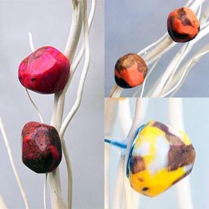 FIMO polymer clay earrings in marbled reds, oranges and yellows.