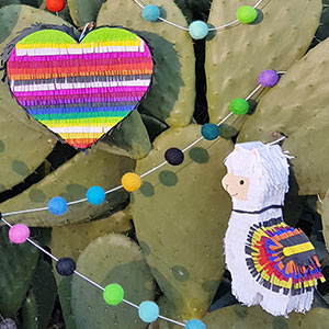 Heart- and llama-shaped piñatas.