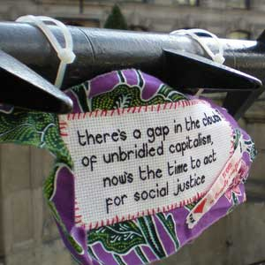 A craftivism (craft plus activism) sign in London.