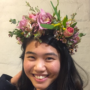 A woman wearing flower crown