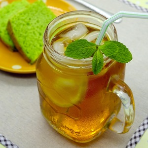 A glass of iced lemon and mint tea.