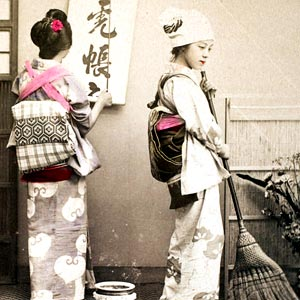 Two geishas tidying and organising a room.