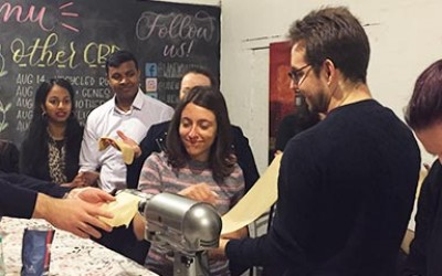 A group making pasta from scratch.