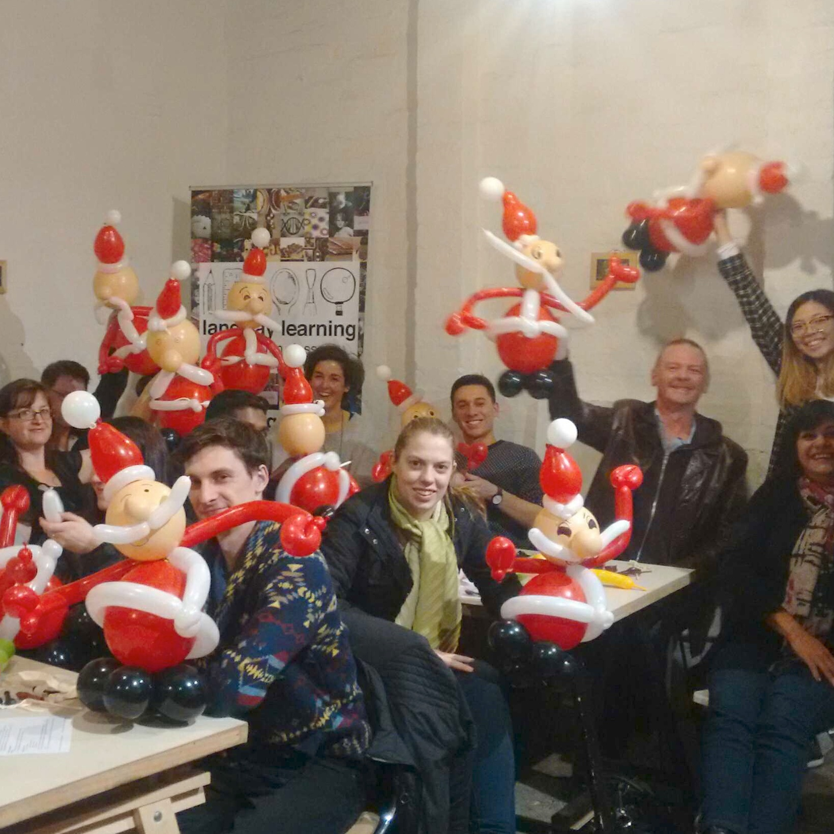 People showing their balloon Santa Clauses