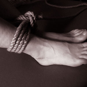 Ankels tied in the Shibari practice of rope bondage.