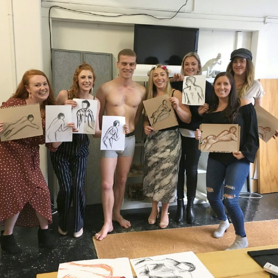 A life drawing class with model and hens